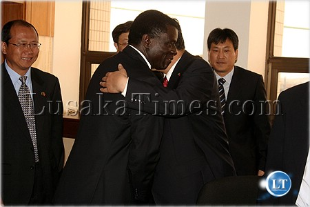 Mines minister Maxwell Mwale hugs investors in the mining sector
