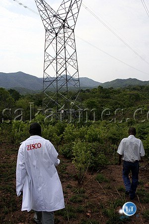 ZESCO LTD engineers inspecting power pylons at Kafue Gorge station'