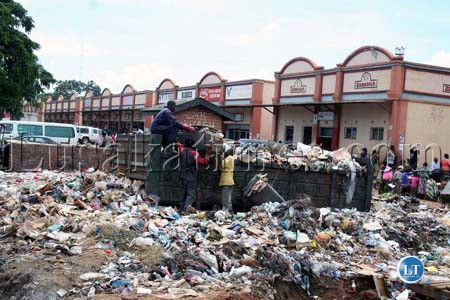 File:Garbage piling at Luburma market