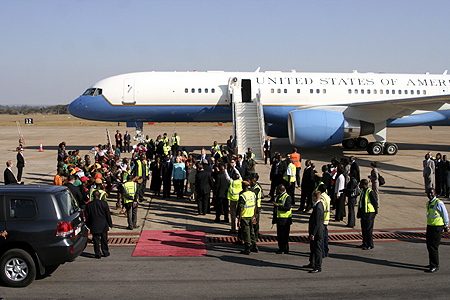 Part of security and dignitories welcome United States Secretary of State Hilary Clinton when she arrived in Zambia at Lusaka international airport.