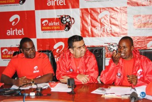 Looking on are Airtel customer service director Mato Shimabale (l) and Airtel marketing