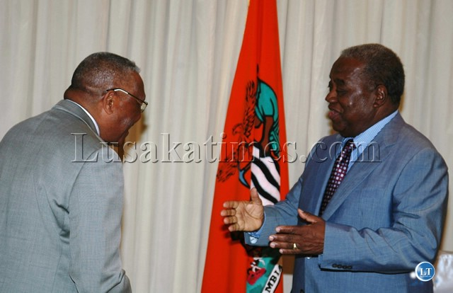PRESIDENT Rupiah Banda confers with Dr,Austin Sichinga during the occasion of the dissolution of the National Assembly at State House