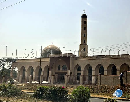 The construction of a mosque in Lusaka's Rhodes park residential area is almost complete. Here workers, doing final touches to the surrounding
