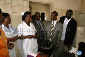 Dr. Joseph Kasonde talking to a health personal at prisons clinic