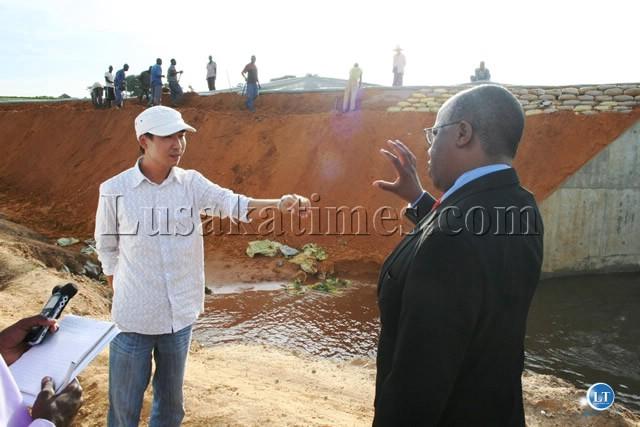 Western Province Minister Nathaniel Mubukwano speaking to China New Era Chief engineer Feng Liyon during the inspection of works on the Sesheke- Senanga road
