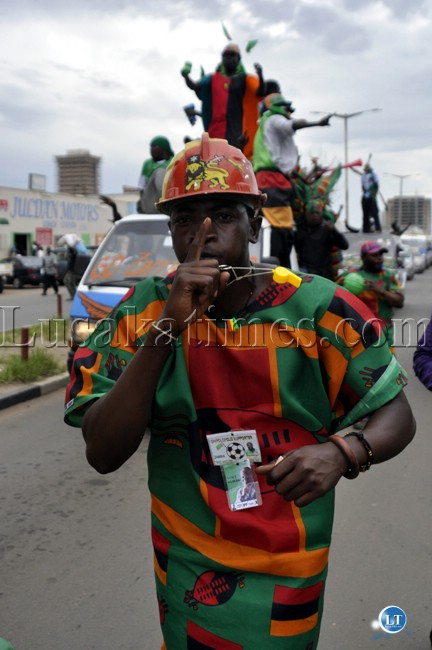 A soccer fan shows the Patrotic Front 'donchi kubeba'  symbol in support of the Zambia National Soccer team in Lusaka.