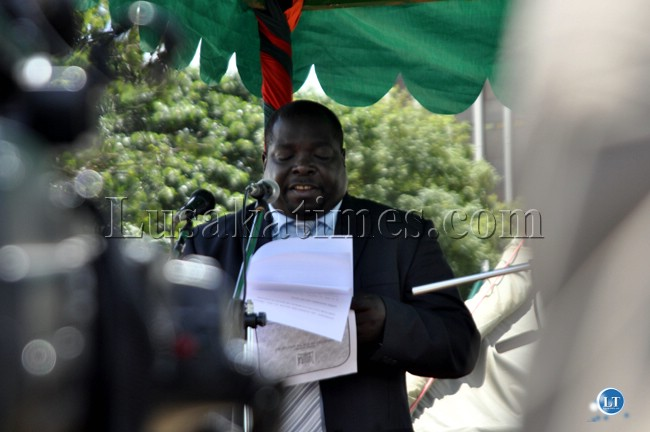 Youth and Sports Minister Chishimba kambwili reads a speech during the Youth day celebrations in Lusaka