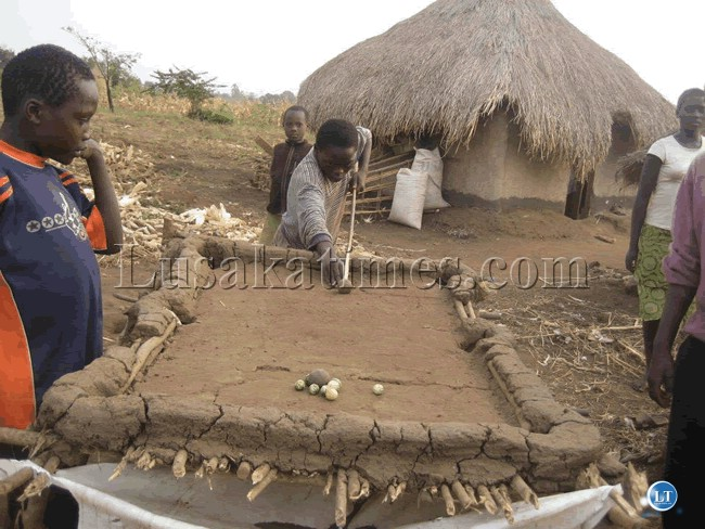 A game of pool in a village in rural Zambia.Courtesy of UNHCR Zambia