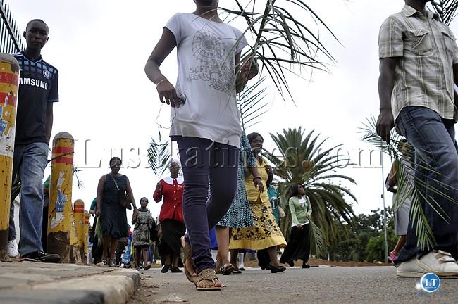 Christians walking during palm sunday celebrations in Lusaka. last week.