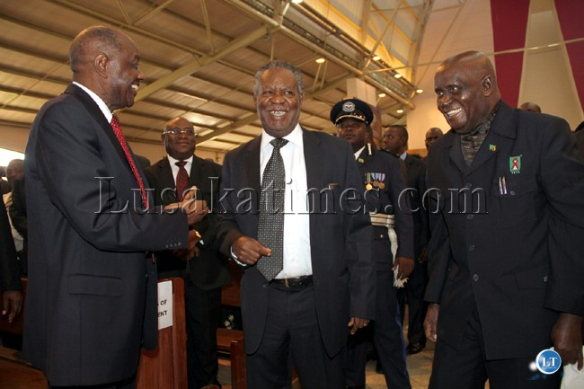 Former President Kenneth Kaunda,President Sata and Vernon Mwanga share a light moment during  the requiem Mass of George Kunda at the Cathedral of the Chld Jesus In Lusaka.Courtesy State House press unit