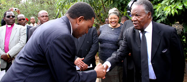 United party for National development president Hakainde Hichilema (l) greets President Sata during the funeral service of late Princess Nakatindi Wina at the Cathedral of the Holy cross in Lusaka