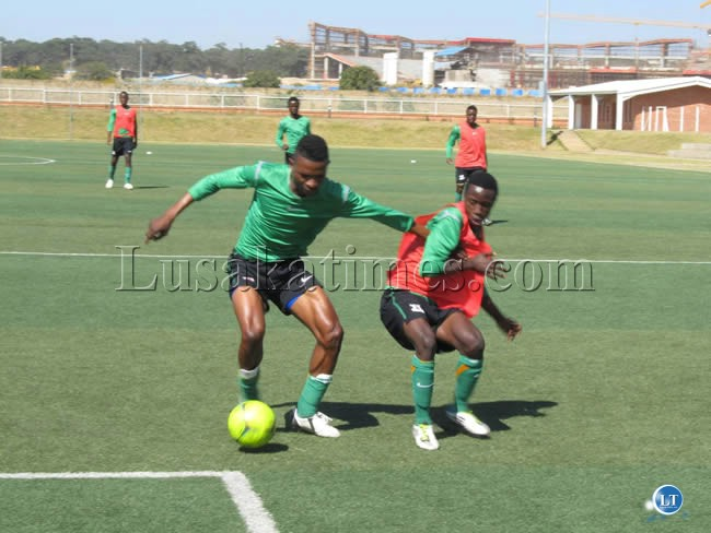 Chipolopolo defender Nyambe Mulenga and Lubambo Musonda during the training session at Olympic Youth Development Center in Lusaka