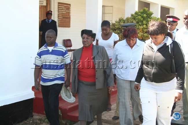 Central province Permanent Secretary Inutu Suba iswhisked away by police officers after civil servants threatened to grag her out of her office