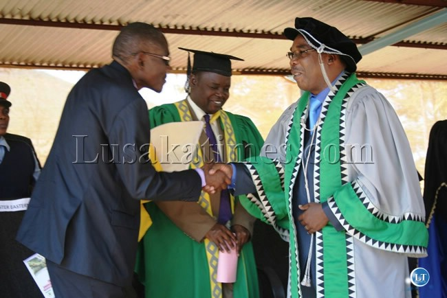 EASTERN Province Minister, Charles Banda, shakes hands with University of Zambia Vice Chancellor, Professor Stephen Simukanga