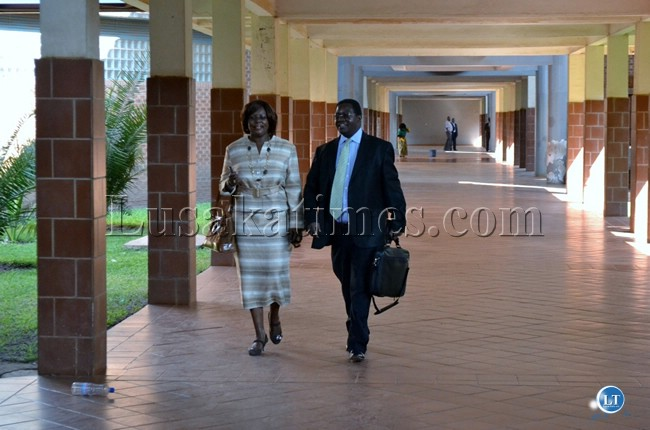 Former Communications and Transport Minister Dora Siliya leaves the Lusaka Magistrate court with lawyer Erick Silwamba