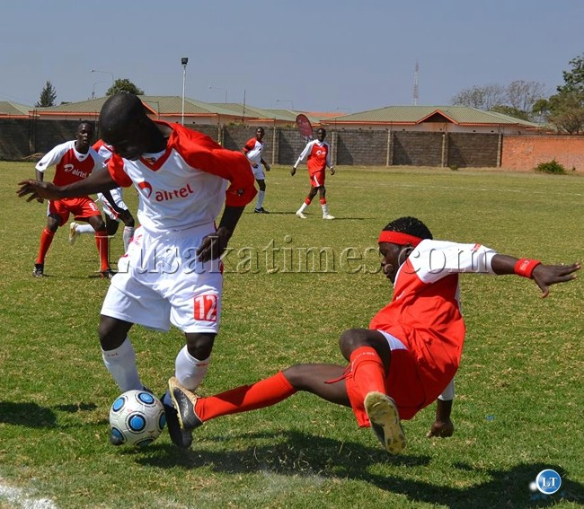 Lee Kanjanja of Lusaka slides tackle Moses Chambwe of Southern Province during a match between Lusaka and Southern province in the on going Airtel Rising stars competition