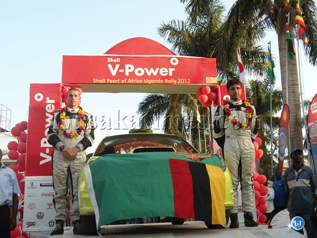 Mohammed Essa (r) and his Zimbabwean co-driver Greg Stead on the Shell Pearl of Africa Uganda Rally podium on Sunday at Silver Springs hotel where he won the national rally in that country
