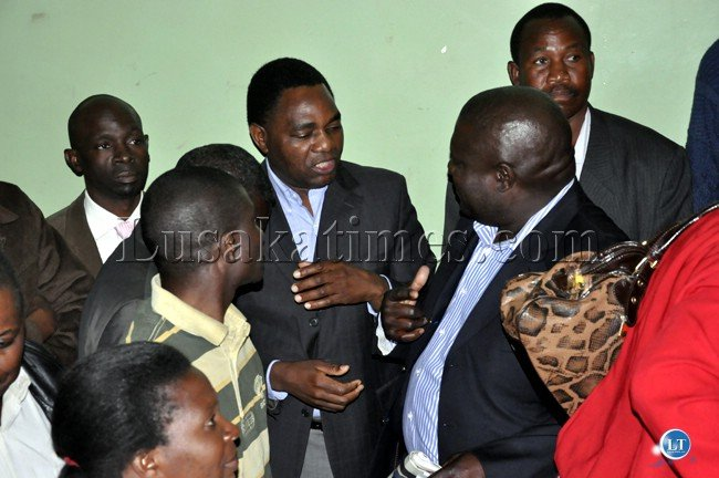 Hakainde Hichilema with party officials before a tear gas canister was blown inside the Lusaka Central Police Station