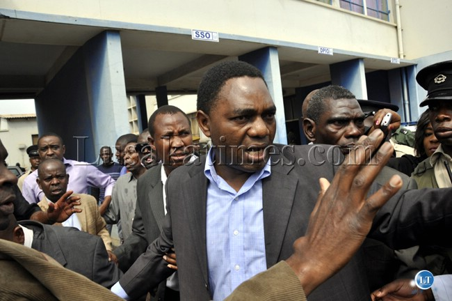 UPND president Hakainde Hichilema reacts after he was among the party officials teargassed at the Lusaka Central Police Station