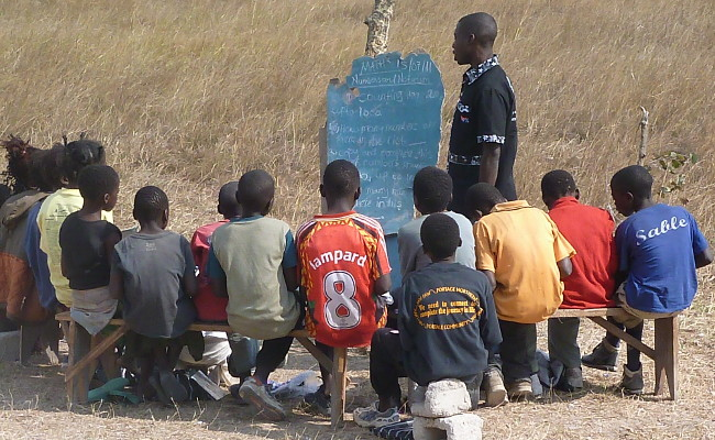 FILE: A class meets under a tree in Mwalubemba village, Zambia