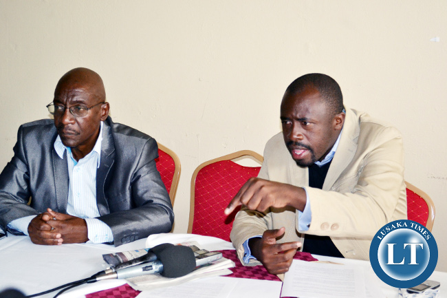 Former Committee of Citizens Executive Director Gregory Chifire (right) addresses journalists as Political Consultant John Ziba looks on at Chainama Hotel in Lusaka