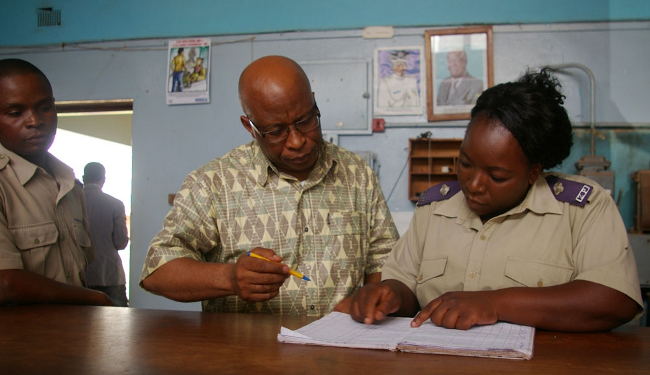 MMD president Nevers Mumba indicating his details in the police register at Kitwe East police station