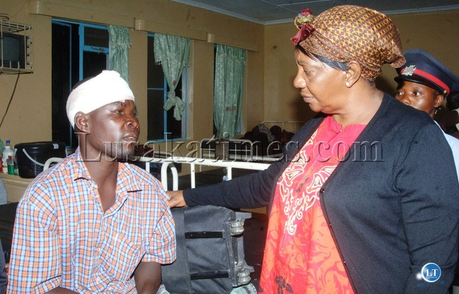 Mansa District Commissioner Mirriam Kauseni visiting one of the accident victims Fred Kalebwe who is nursing serious injuries in Serenje District Hospital