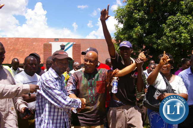 Nevers Mumba and his supporters after being granted bail