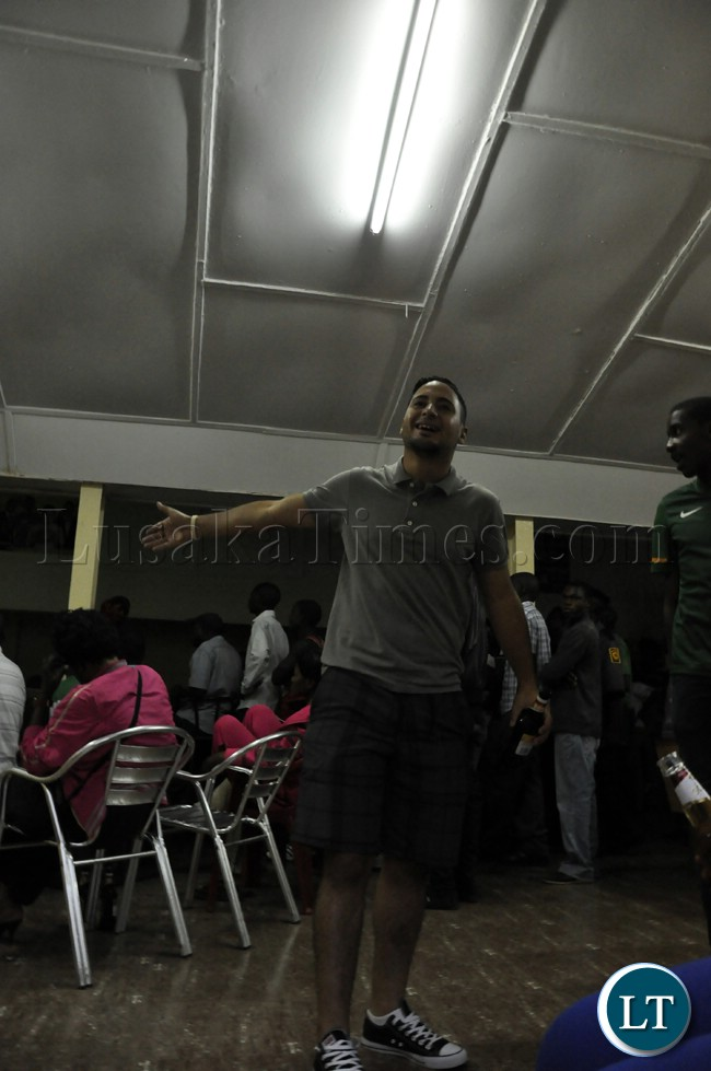 A soccer fan reacts after Zambia missed scoring opportunities during the match against Bukina Faso