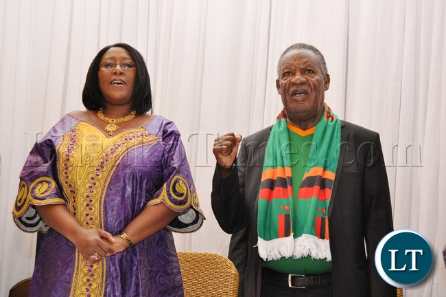 First Lady Dr Christine Kaseba and President Michael Sata singing the national Anthem  at Protea Hotel Nelspruit in South Africa where President Sata addressed the National Team  players
