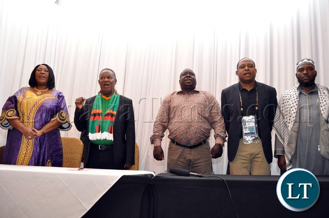 First Lady Dr Christine Kaseba, President Michael Sata, Sports minister Chishimba Kambwili, FAZ President Kalusha Bwalya and South African premier  singing  the National Anthem at Protea Hotel Nelspruit in South Africa where President Sata addressed the National Team