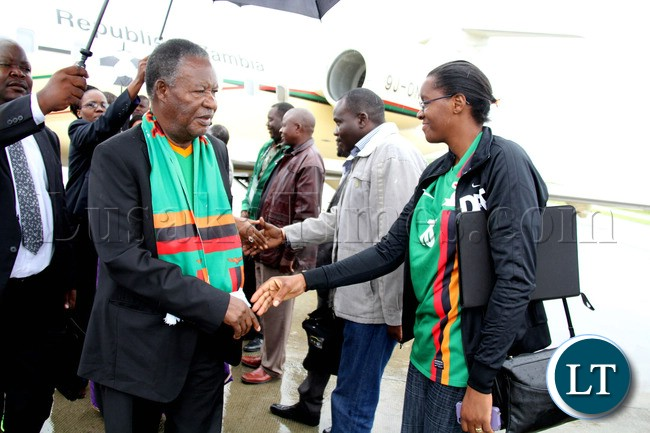 President Michael Sata greets the Zambia official on arrival in Nelspruit, South Africa where President Sata addressed the  National Team  players
