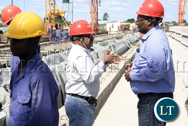 (Mongu-Kalabo Road) Rankin Resident Engineer Ramesh Suryawanshi explaining  on the site  to Western Province Permanent Secretary Emmanuel Mwamba during the tour of the AVIC bridge department at their comp site of Mongu–Kalabo