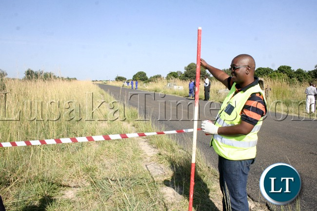 Mongu Council Land surveyor Jones Siangandu making sure that all the measurements are put straight for site