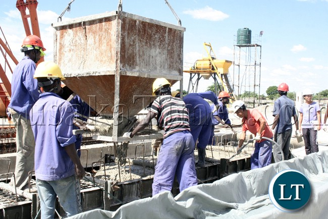 (Mongu-Kalabo Road) Workers at AVIC bridge department busy working on time for the bridges of Mongu- Kalabo Road