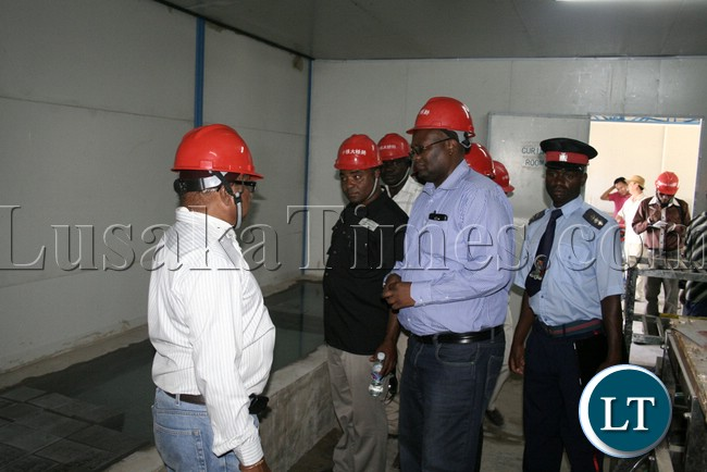 (Mongu-Kalabo Road) Western Province Permanent Secretary Emmanuel Mwamba and entourage visit the test lab during the tour of the AVIC bridge department at their comp site of Mongu–Kalabo Road