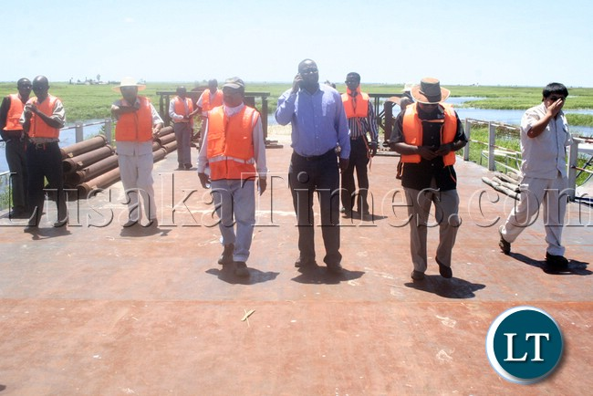 (Mongu-Kalabo Road) Western Province Permanent Secretary Emmanuel Mwamba third from (r) touring the temporal  bridge which was put up by AVIC on the Zambezi River during the visits of the bridge on Mongu –Kalabo Road