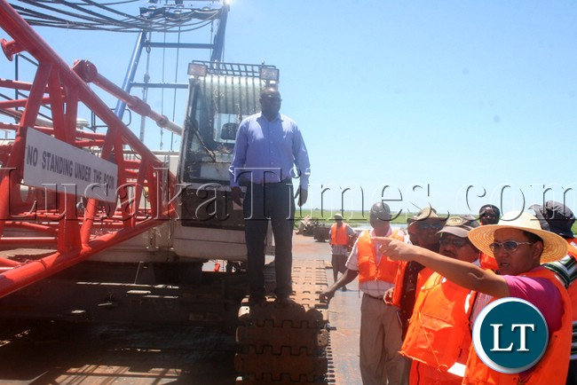 (Mongu-Kalabo Road) Western Province Permanent Secretary Emmanuel Mwamba inspecting temporal bridge at the Zambezi River along Mongu yesterday –Kalabo Road
