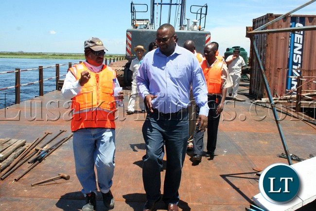 (Mongu-Kalabo Road) Rankin Resident Engineer Ramesh Suryawanshi and Western Province Permanent Secretary Emmanuel Mwamba inspecting temporal bridge at the Zambezi River along Mongu –Kalabo Road