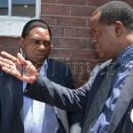 FILE: UPND president Hakainde Hichilema (left) interacting with his lawyer Jack Mwiimbu