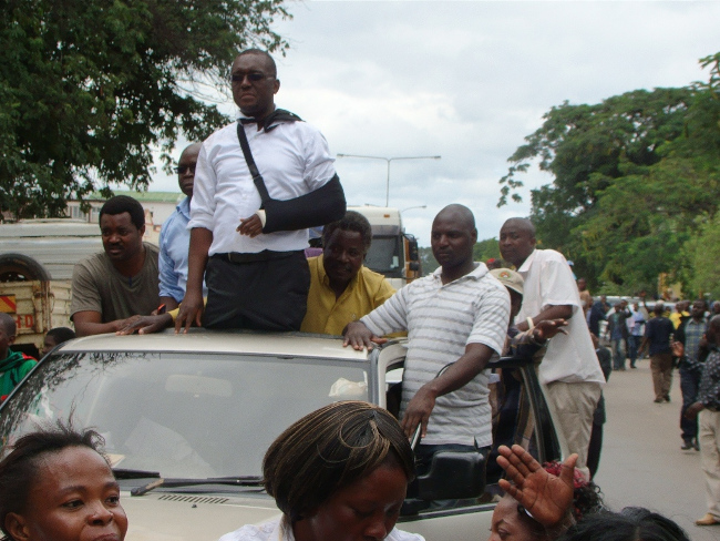 MAZABUKA Central Member of Parliament Garry Nkombo (with arm band) and seven others took to the streets with UPND supporters in celebration over the discontinuation of the case and walk to freedom in Livingstone