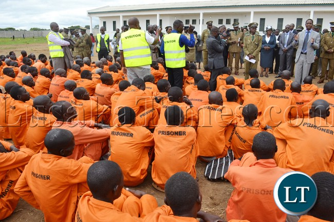 HOME Affairs Minister Edgar Lungu (far right) addresses inmates after commissioning the newly built Mwembeshi Maximum security prison in Mumbwa district