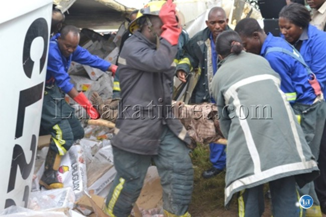 Rescue officers retrieving the body of the accident victim which occurred at Wusakile Roundabout