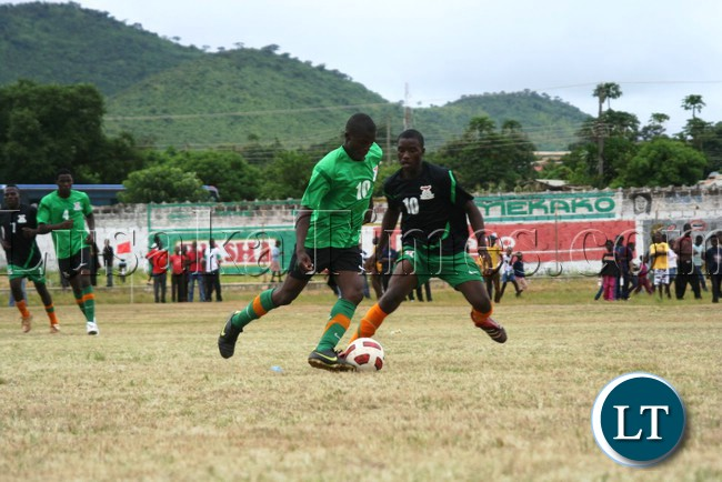 KELVIN Chomba ( in green) tries to beat Fashion Sakala to the ball during a FAZ talent identification match at David Kaunda Stadium in Chipata on Tuesday.