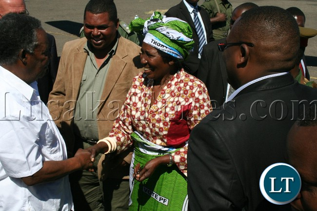 Minister of Gender and child Development Inonge Wina welcomes President Michael Sata shortly after the President arrives at Mongu airport ahead of by-elections for Lukulu west