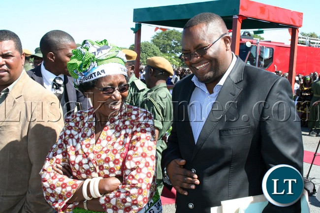 Minister of Gender and child Development Inonge Wina and Western Province Permanent Secretary Emmanuel Mwamba having the light moment shortly before President Michael Sata arrives at Mongu airport ahead of by-elections for Lukulu west