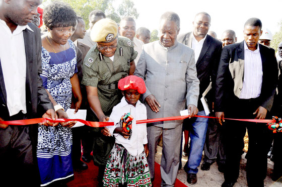 Nalolo' s Wamunyima Mukubesa cuts a ribbon during the launch of the Muoyo Water Supply scheme project by President Michael Sata in Nalolo, Western Province on April 19,2013-Picture by THOMAS NSAMA