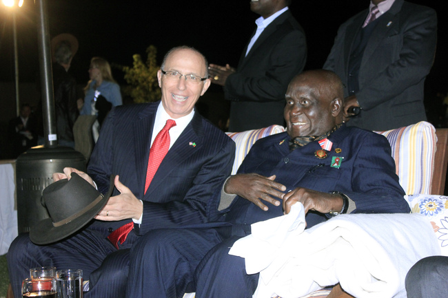 First Republican President Dr Kenneth Kaunda shares a light moment with American Ambassador to Zambia Mark Storella (right) during the commemoration of the 237th United States Independence Day in Lusaka recently.