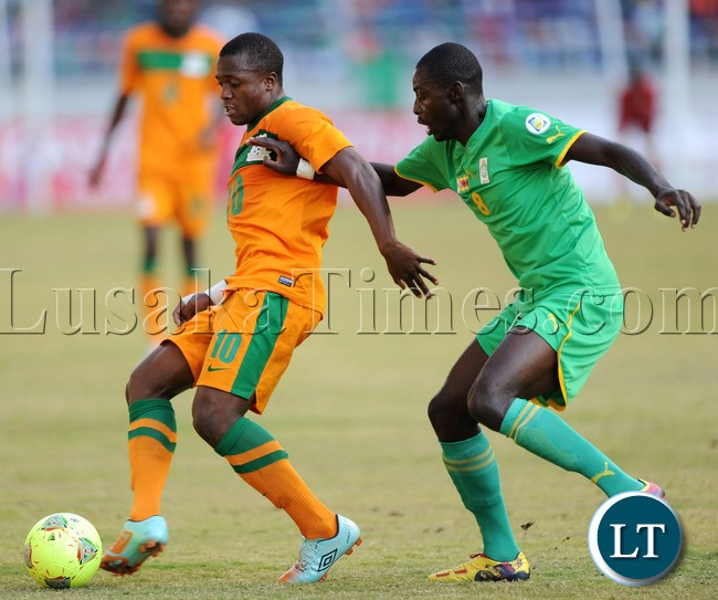 Bornwell Mwape of Zambia challenged by Eric Chipeta of Zimbabwe during the Cosafa Cup Final Match mach between Zimbabwe and Zambia on the 20 July 2013 at Levy Mwanawasa Stadium, Zambia ©Muzi Ntombela/BackpagePix