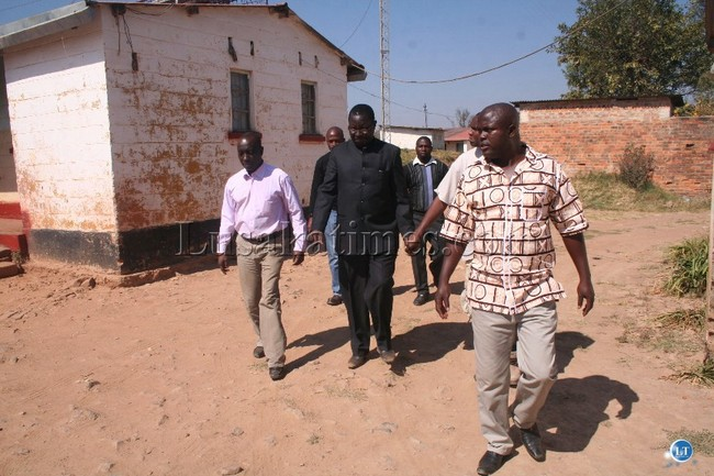 KIPUSHI border Immigration department officer-in-charge Brighton Songiso (right) leads Home Affairs deputy minister Nickson Chilangwa (left) and regional Immigration officer Mufalili Nasilele (middle) during the conducted tour of Immigration houses at Kipushi border post, about 136 km east of Solwezi district  in Solwezi east constituency